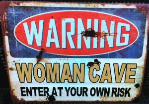 woman cave skylt