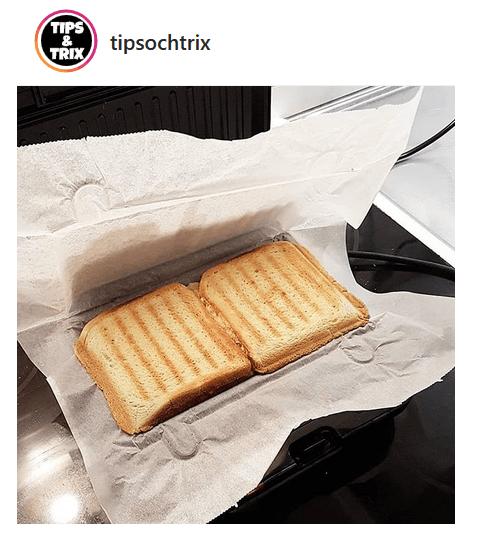Använd bakplåtspapper i smörgåsgrillen