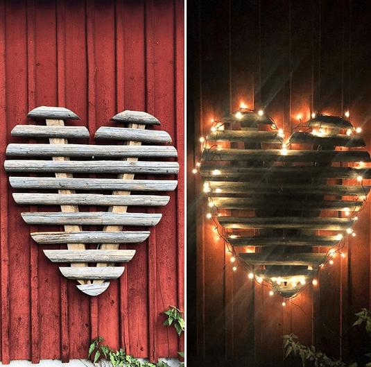Härligt trähjärta till husvägg med ljus